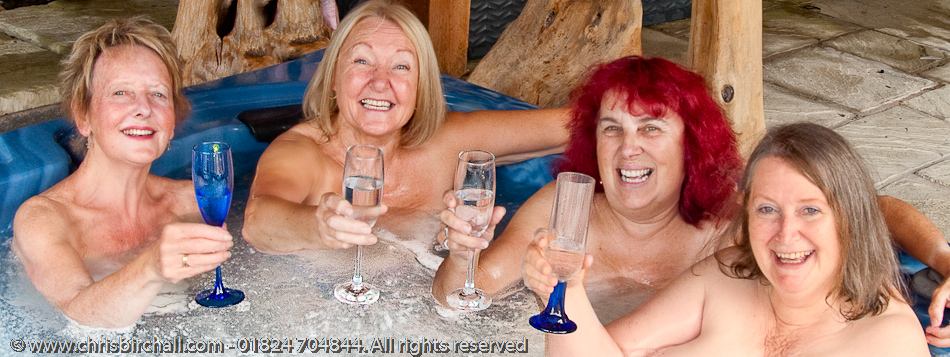 From left: Margaret, Kay, Enys and Barbara relax with a glass of bubbly in a tub full of bubbles after their open air photo session.